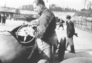 John Cobb stood beside 10.5 Litre Delage. Brooklands Paddock. Early 1930s.